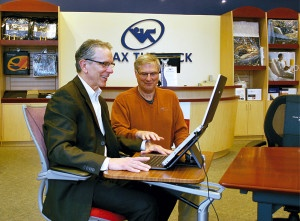 Mike Hall (left) tries ergonomic keyboard, guided by Steve Kaplan at Relax The Back
